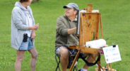 """From left, Addie Hocynec, of Lansdale, Pennsylvania and a painter herself, speaks with fellow artist John Schmidtberger as he paints a picture during the first ever Bucks County Plein Air Festival Wednesday June 8, 2016 at the Mercer Museum in Doylestown, Pennsylvania.  The competitively-selected artists will paint outdoors """"en plein air"""" or """"in open air"""" over the course of three days in various locations throughout the county to create various landscapes and streetscapes. (Photo by William Thomas Cain)"""