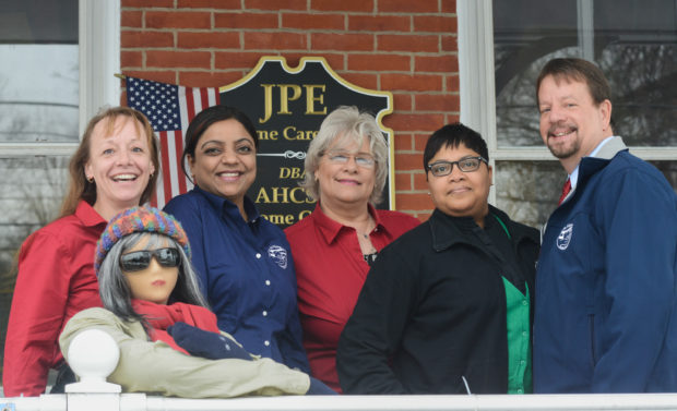 DOYLESTOWN, PA -  FEBRUARY  19: Staff members at At Home Certified Senior Healthcare pose with Marge the Mannequin on the porch February 19, 2014 in Doylestown, Pennsylvania. (Photo by William Thomas Cain/Cain Images)